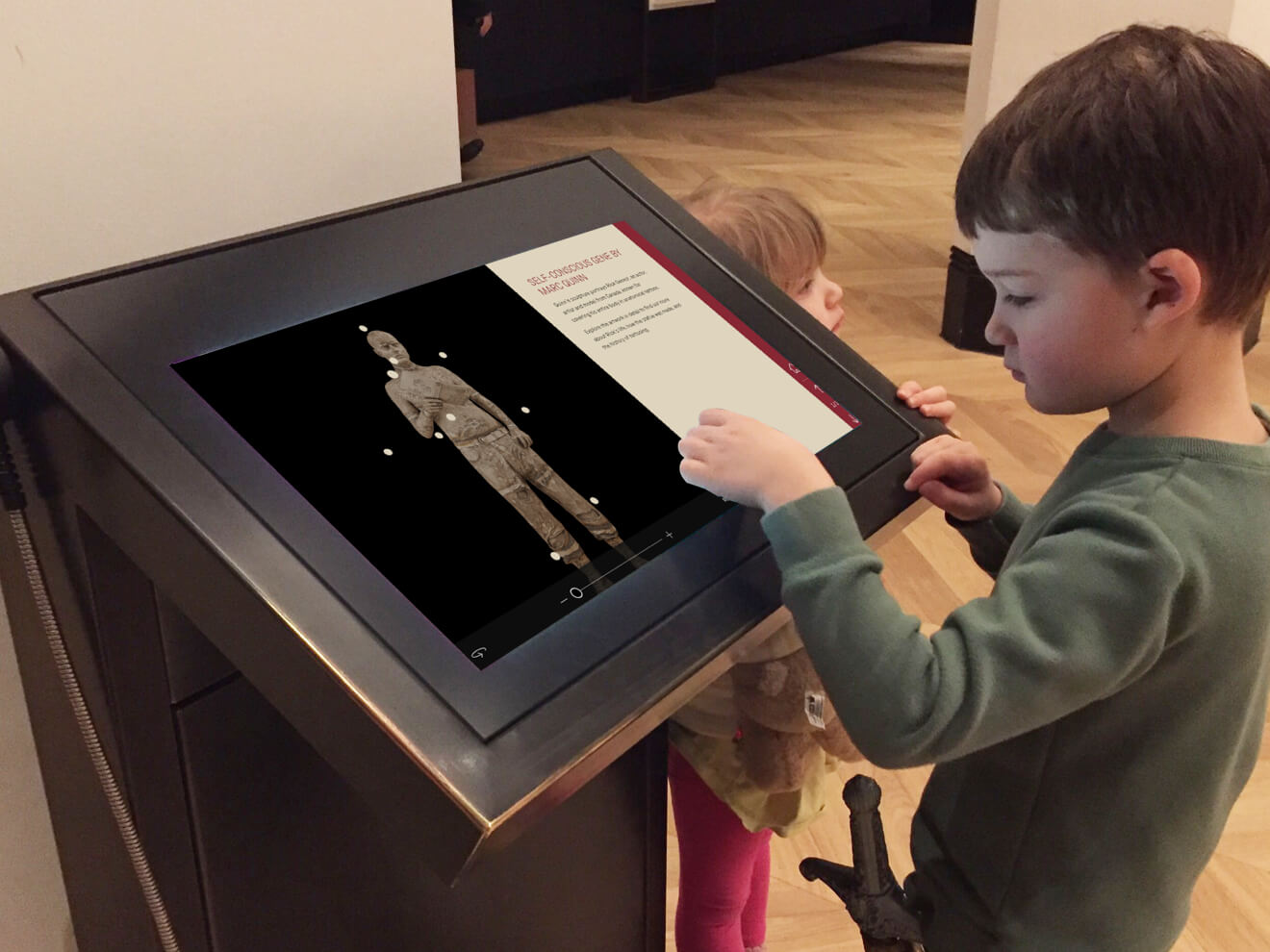 A child playing with the kiosk in The Science Museum