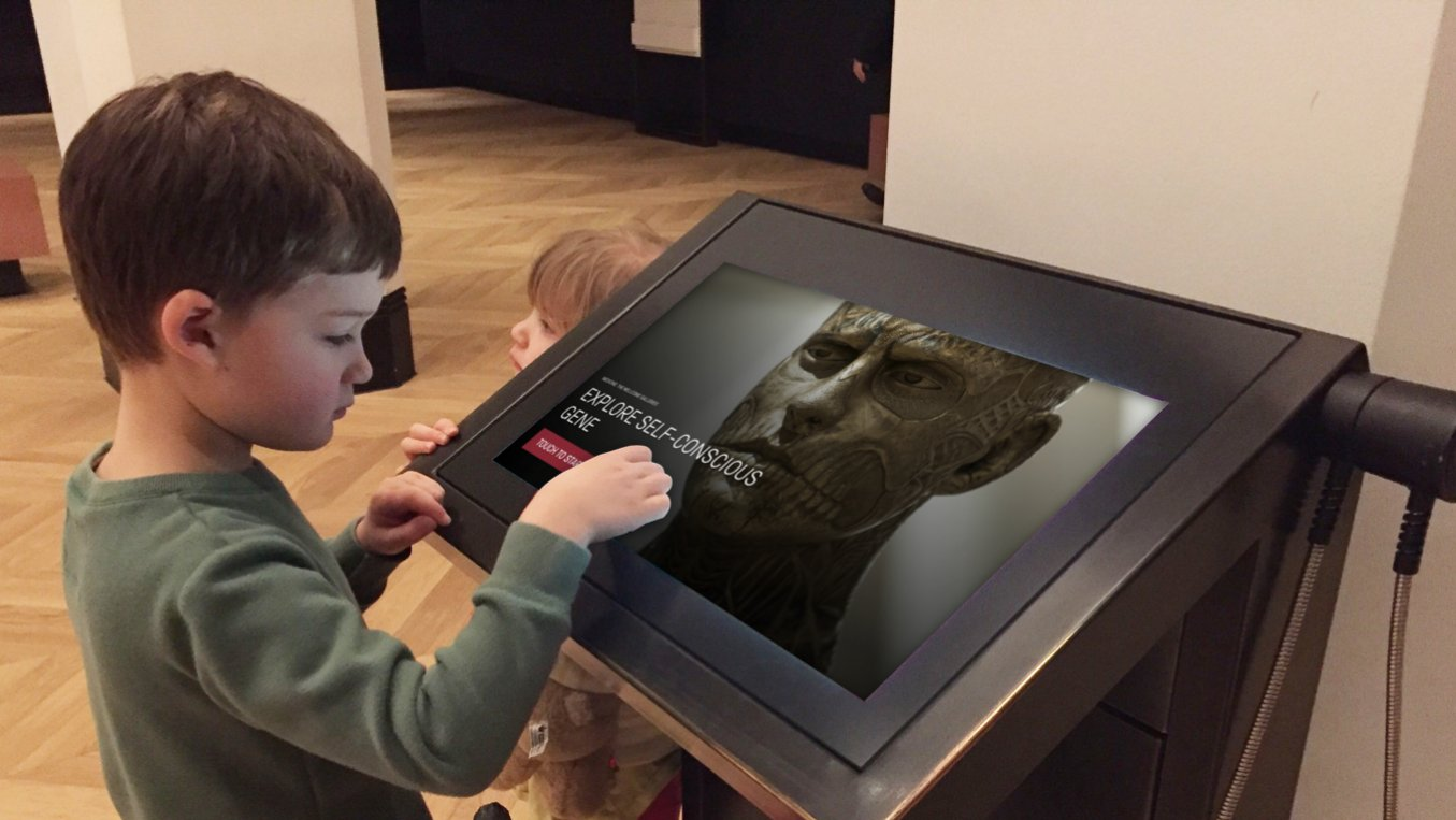 A child playing on the museum kiosk