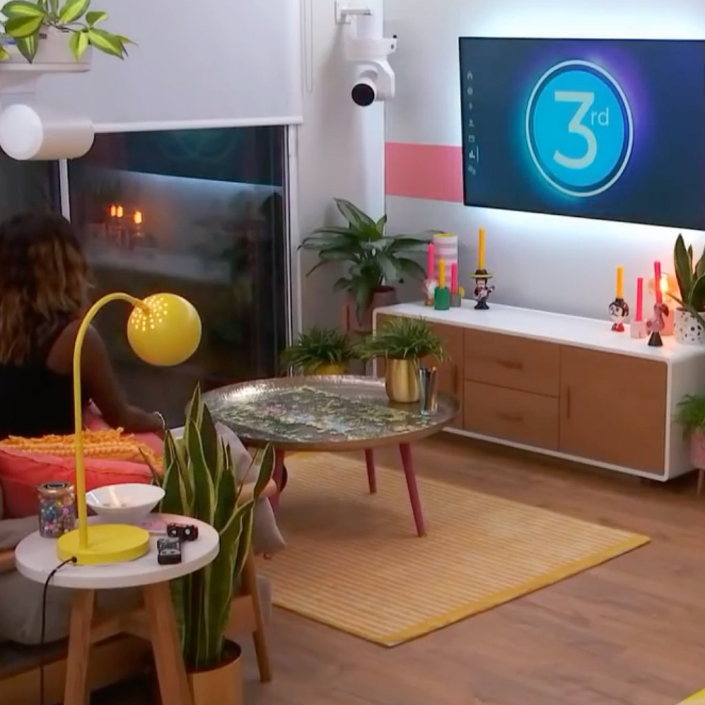 A contestant in her apartment in The Circle
